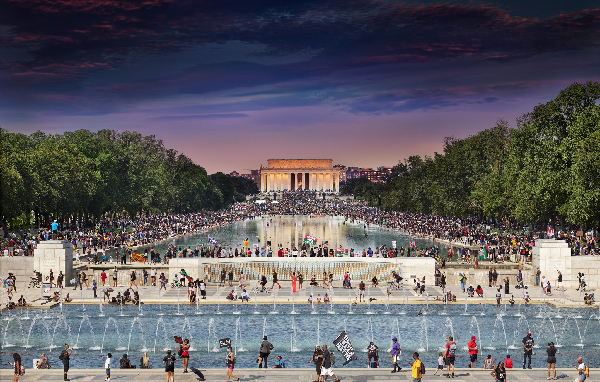 Picture of crowds of people walking along the national mall at dusk
