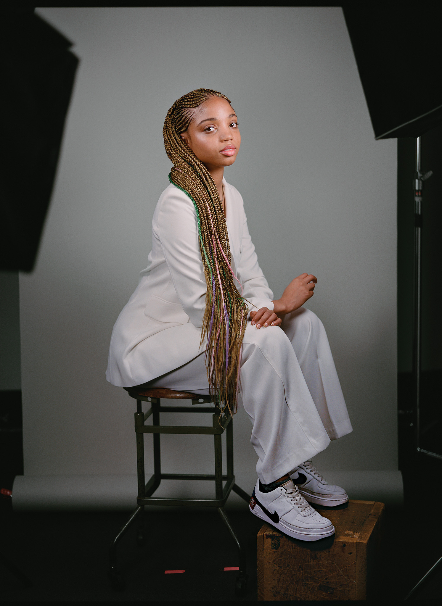 Picture of a woman with long blond braids sitting for a portrait