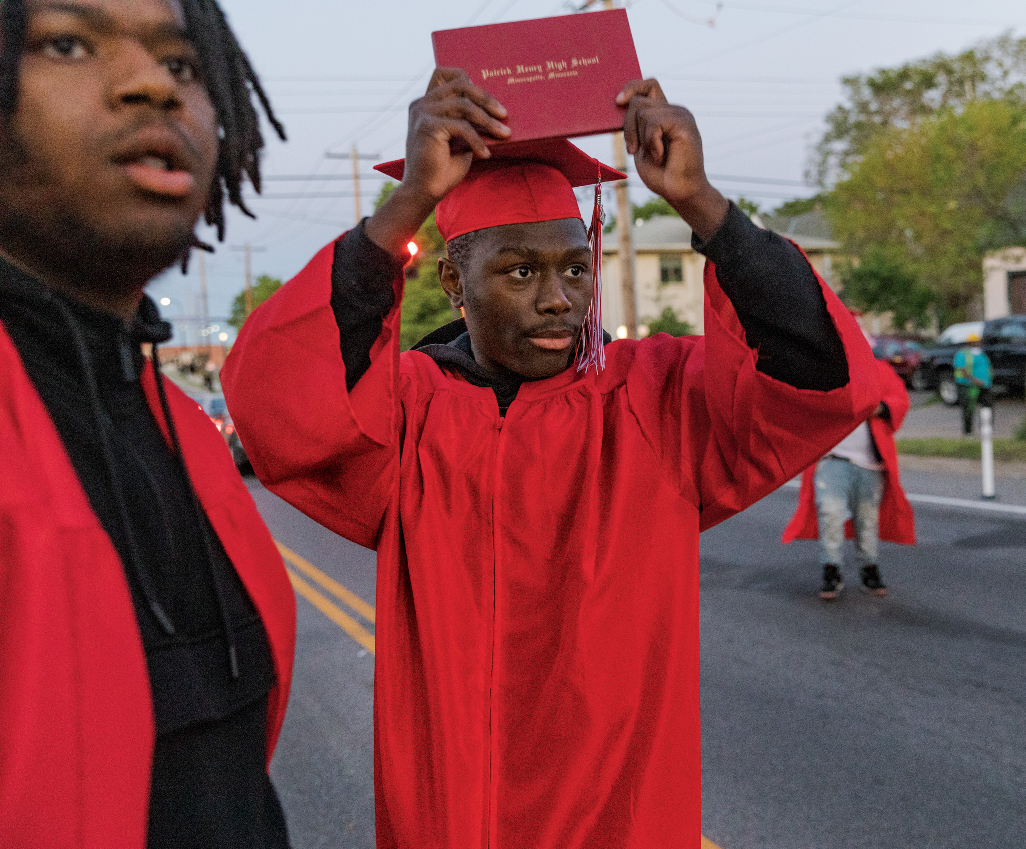 Picture of two recent high school graduates observing protests in Minneapolis