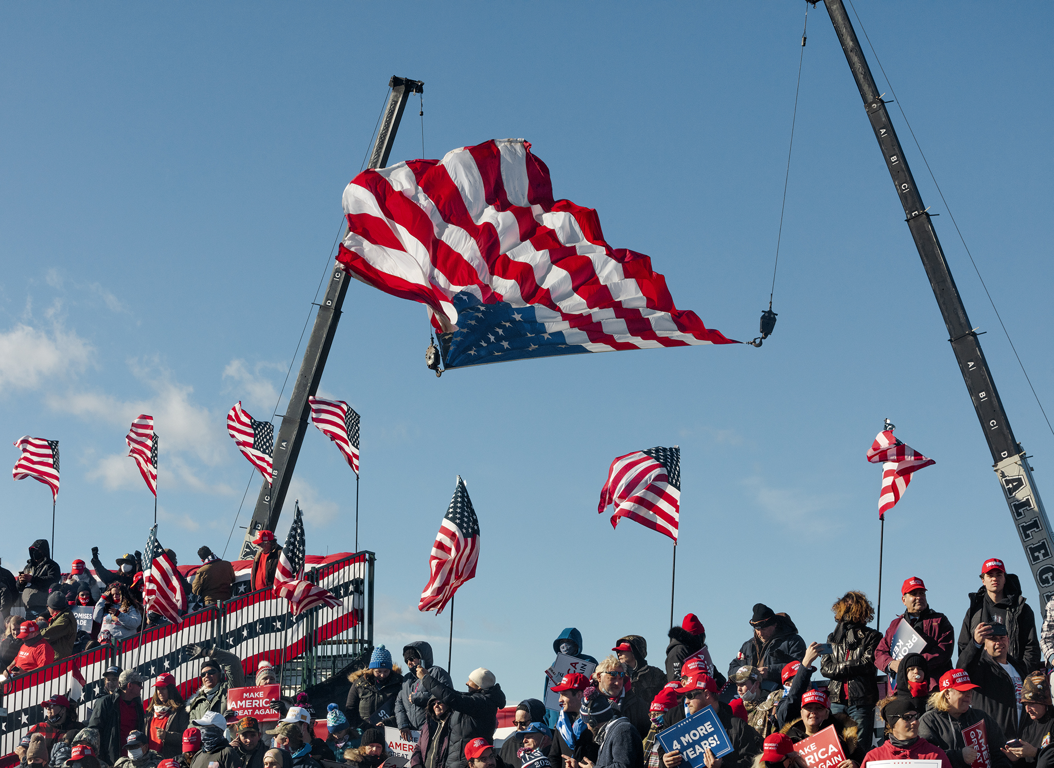 Picture of a flag flying upside down above a large crowd