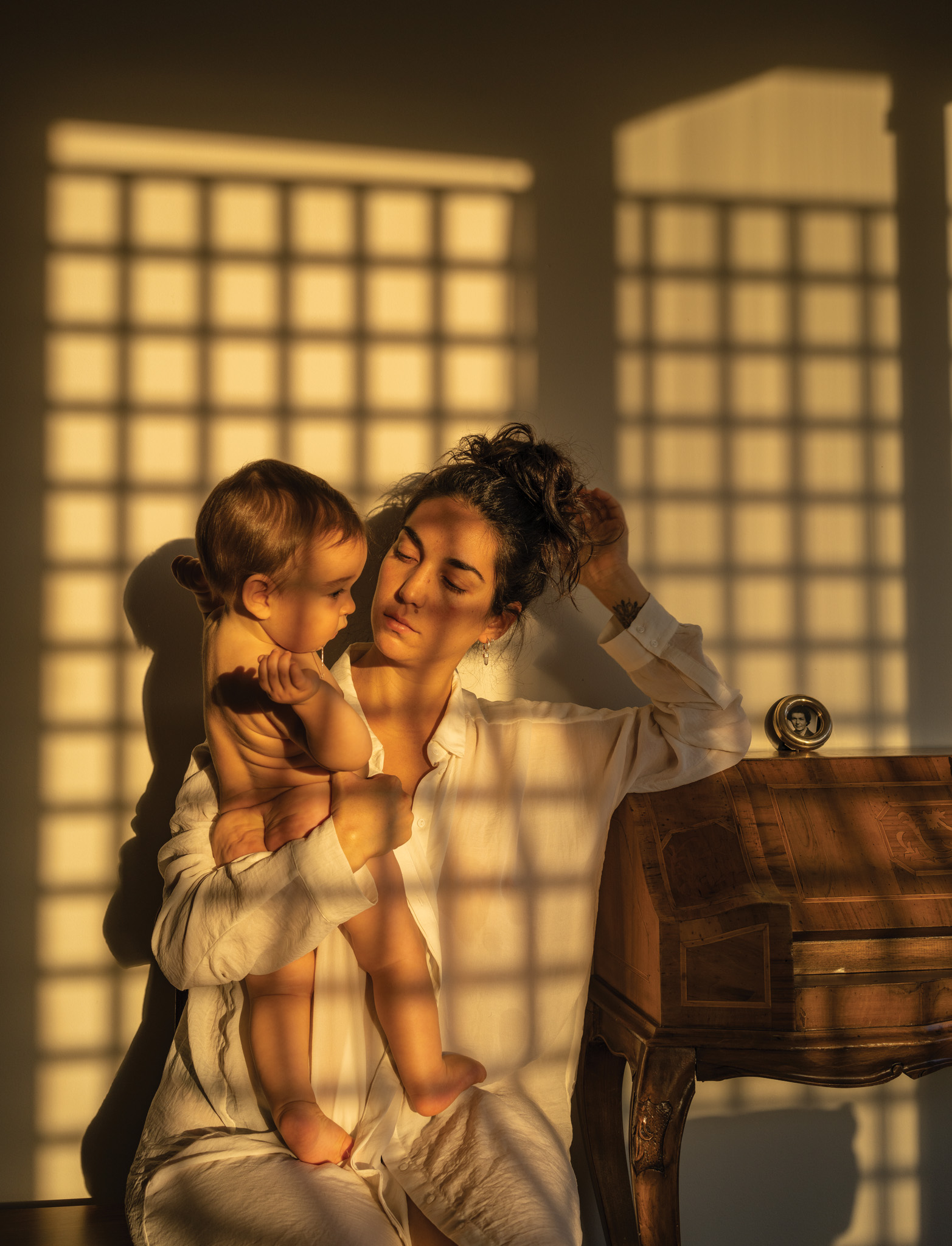 Picture of a mother holding her child in the sunlight