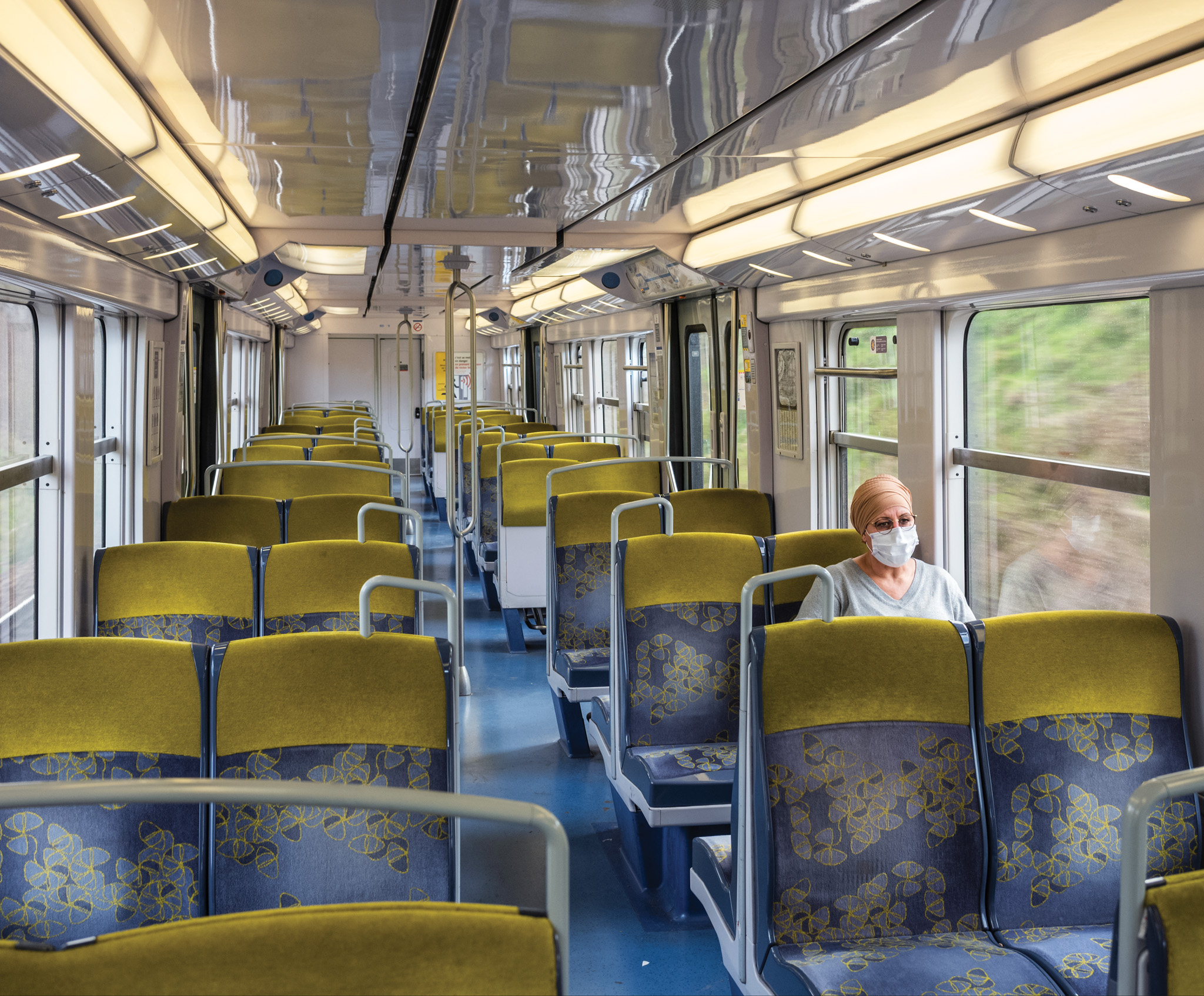 Picture of the interior of a nearly empty train