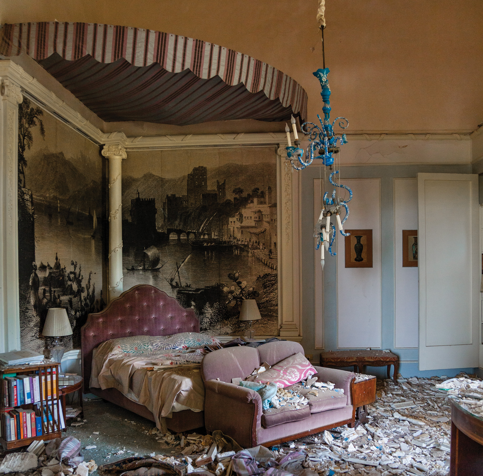 Picture of a bedroom covered in rubble after an explosion