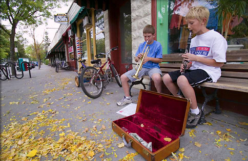 Young musicians give an impromptu concert outside a Boise, Idaho, shop.